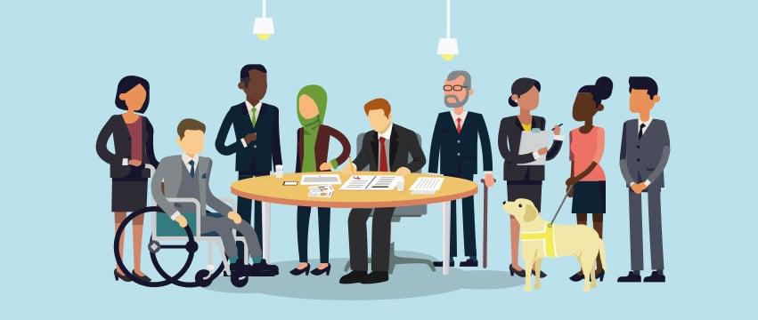 Žmonių grupė aplinks darbo stalą.